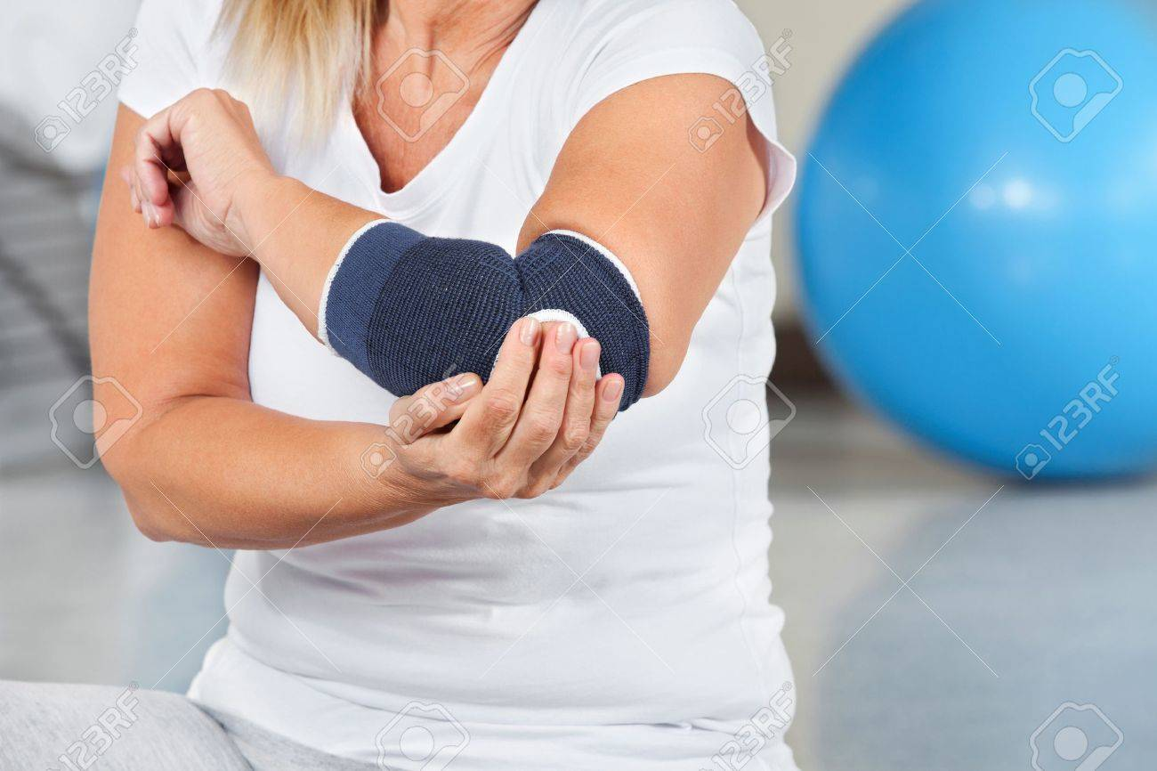 Woman with joint pain and bandage in gym Stock Photo - 13054124