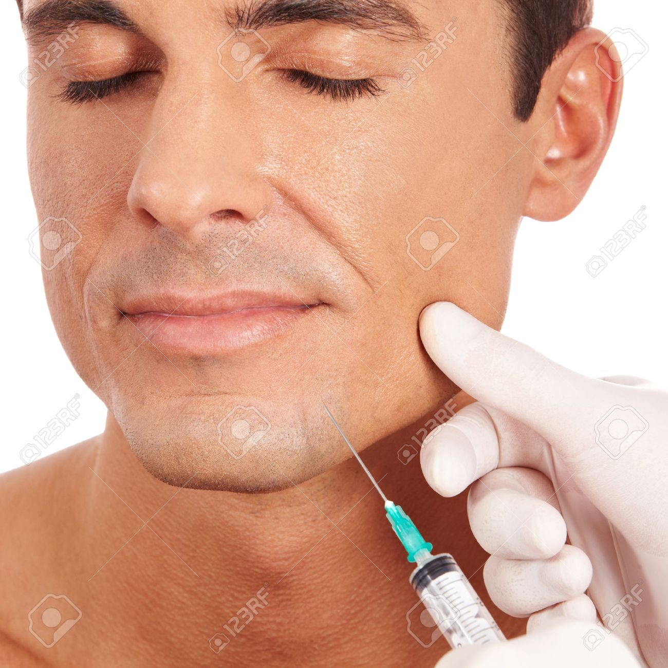 Attractive man at plastic surgery with syringe in his face Standard-Bild - 13713185