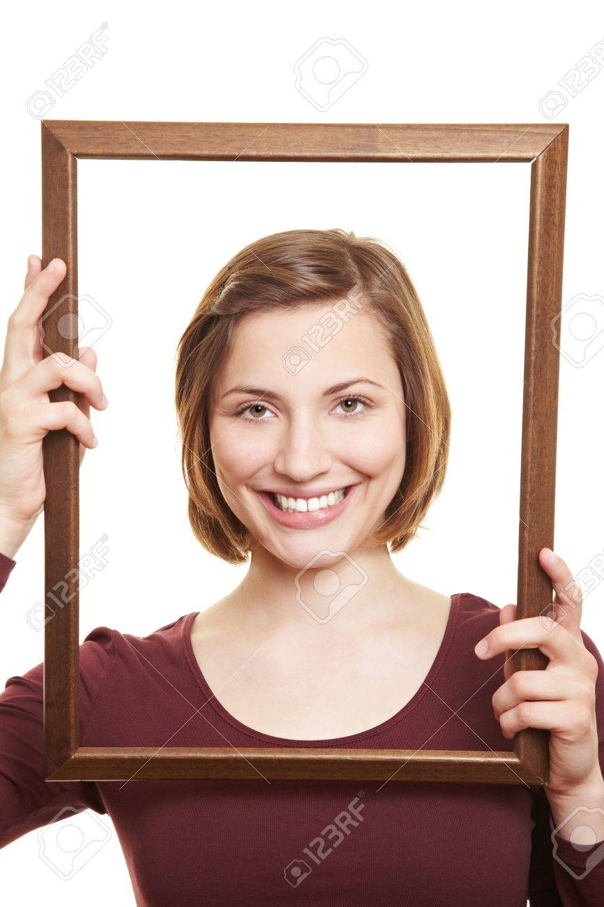 Happy attractive woman in empty wooden picture frame Stock Photo - 14011862
