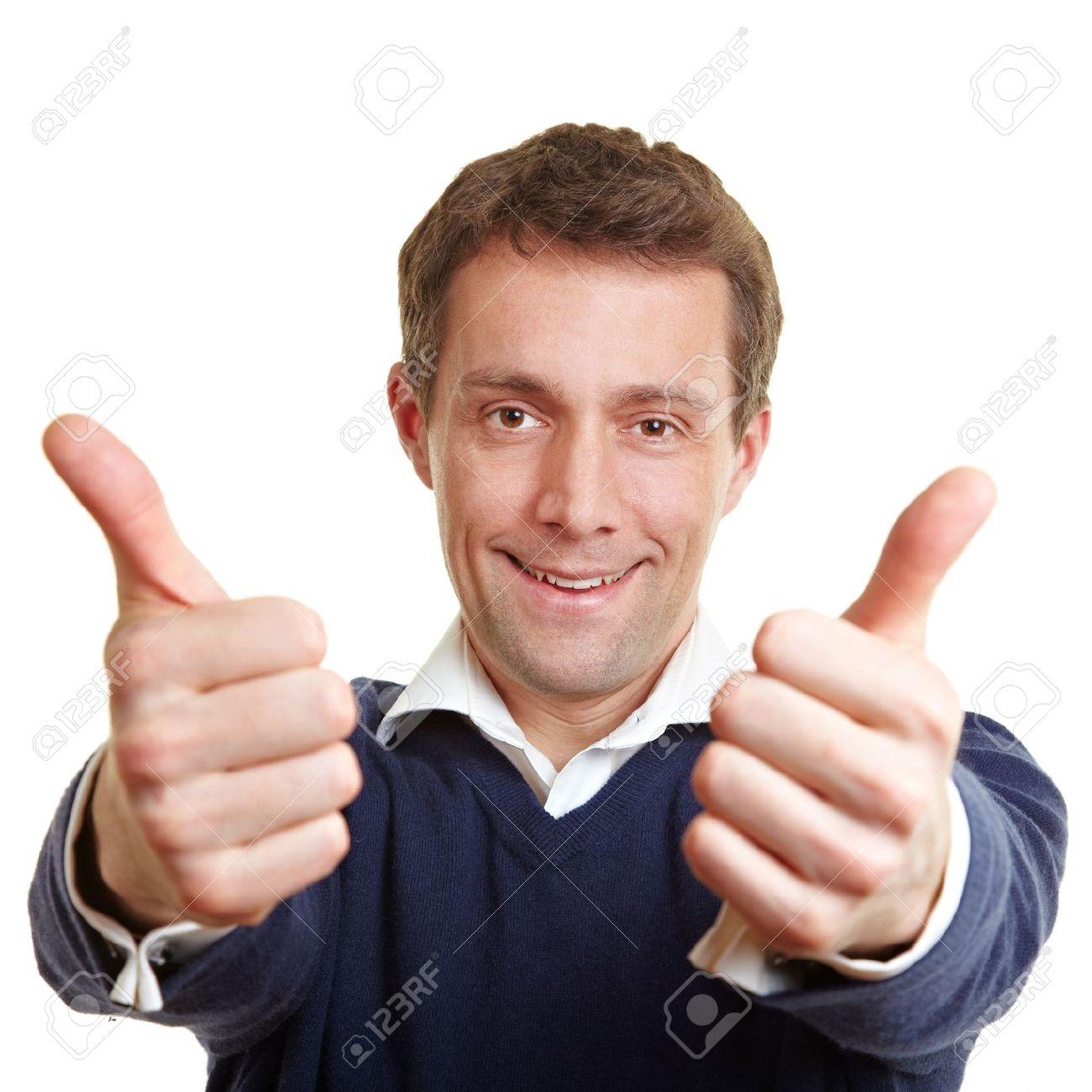 Cheering happy man holding both thumbs up Stock Photo - 14334097