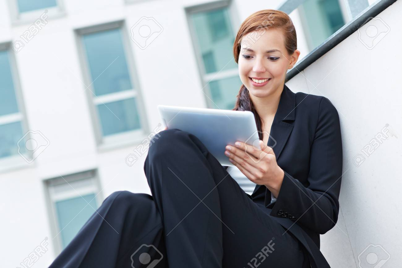 Female student sitting on stairs with a tablet pc Stock Photo - 14961882