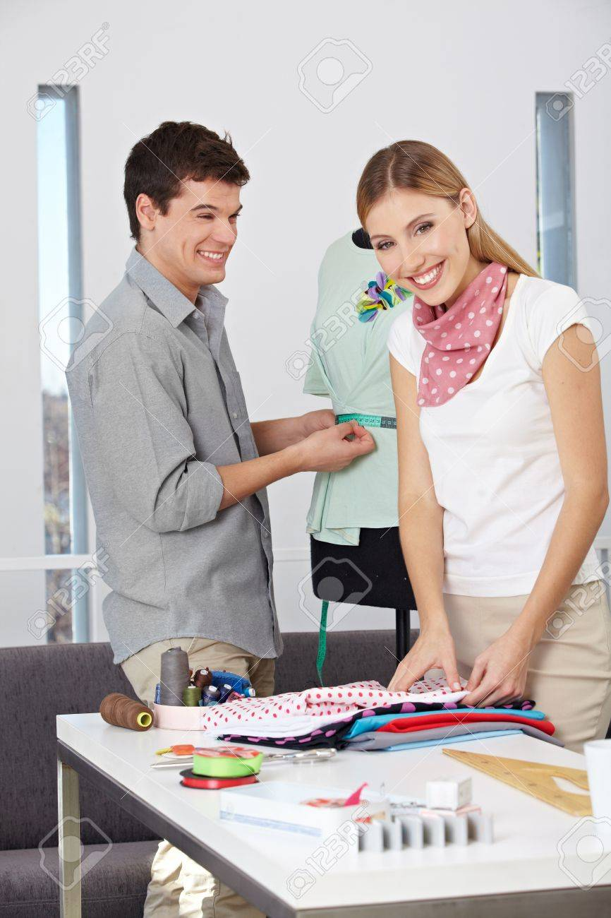 Two happy fashion designer at work with dress form in a studio Stock Photo - 15529998