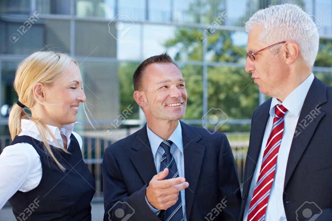 Group of happy business people having a meeting outside Stock Photo - 15719309