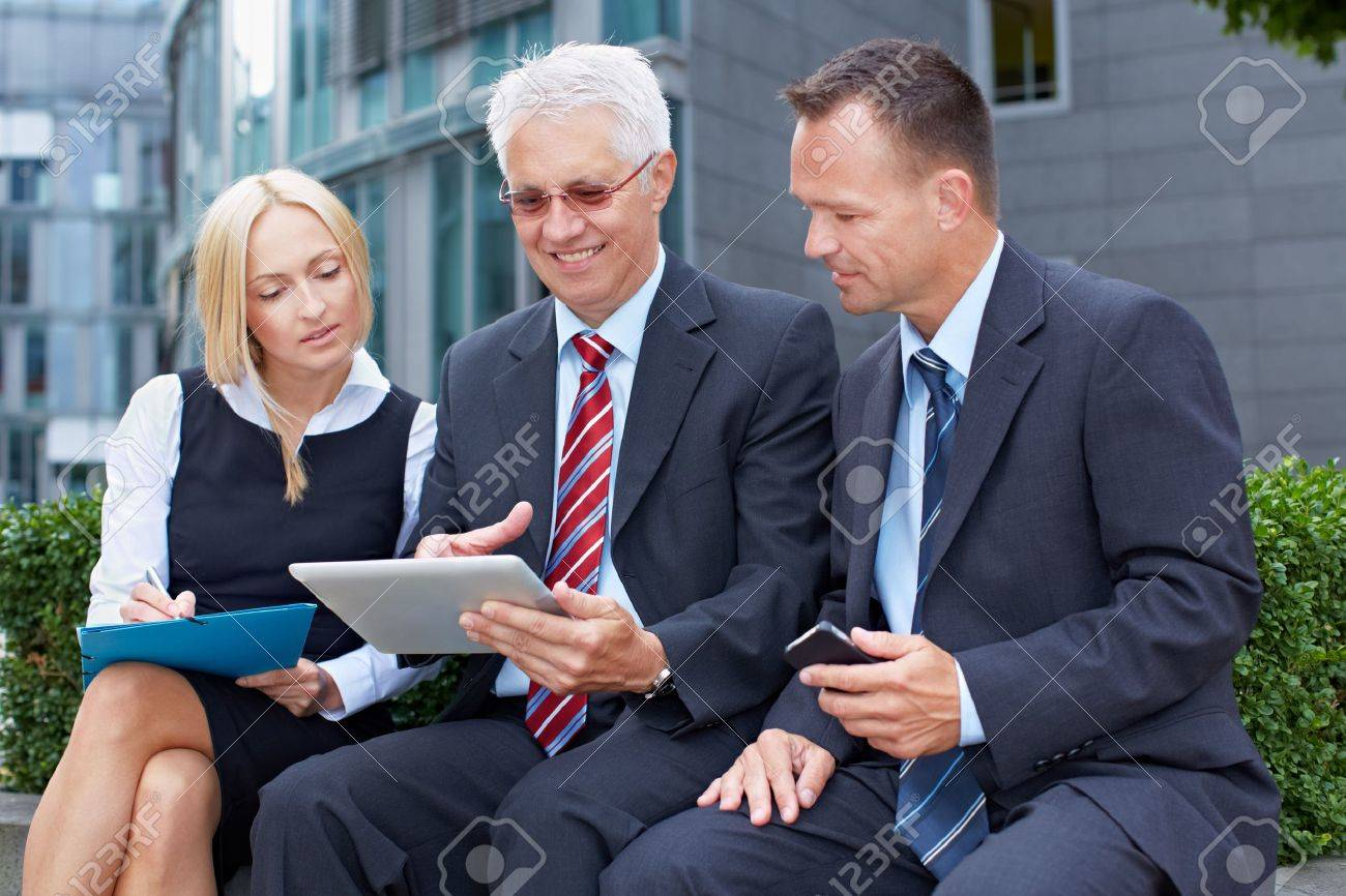 Happy business people team working on a tablet computer Stock Photo - 15812770