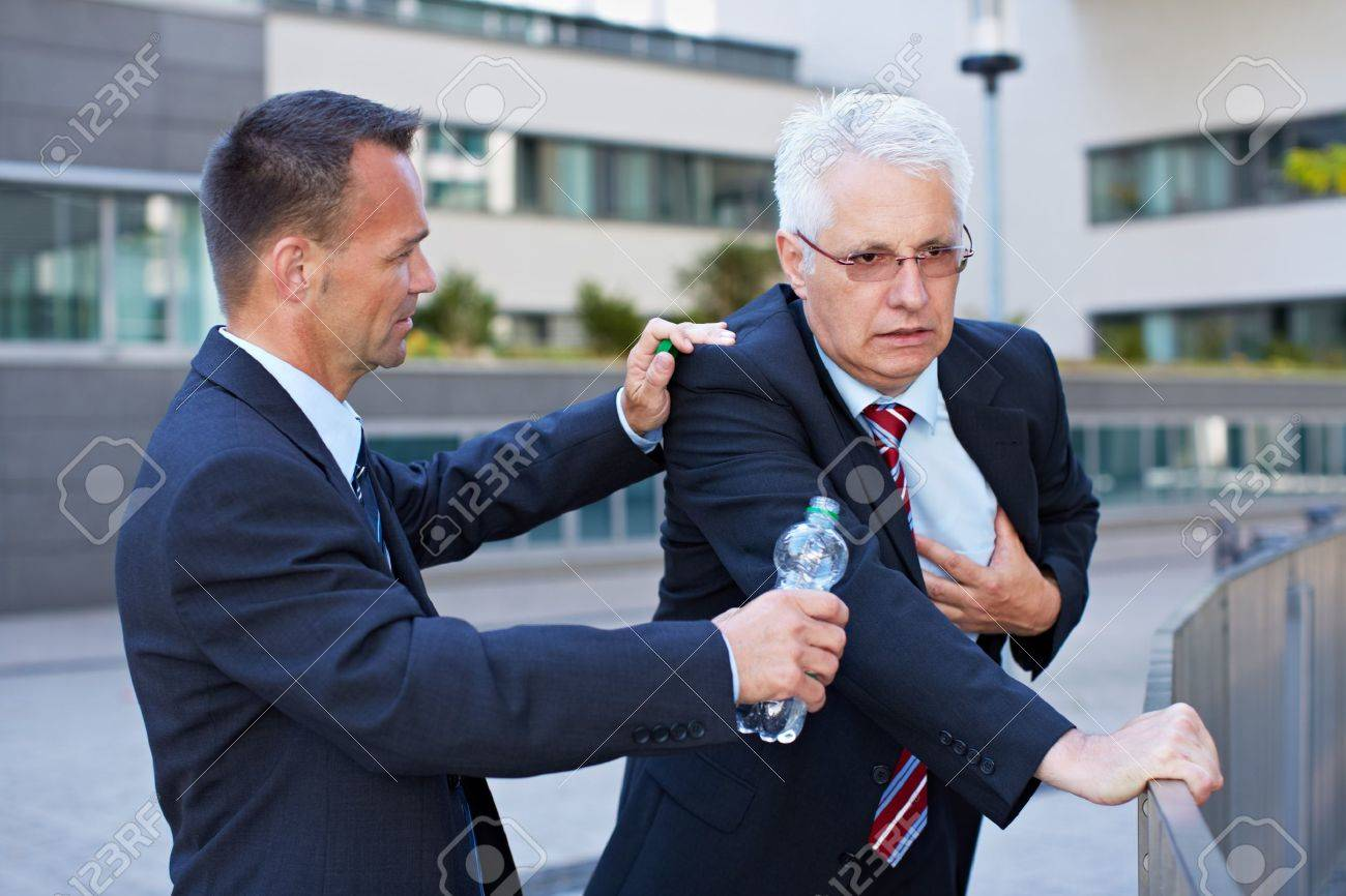 Business man helping senior with heart attack with a bottle of water Stock Photo - 15812744