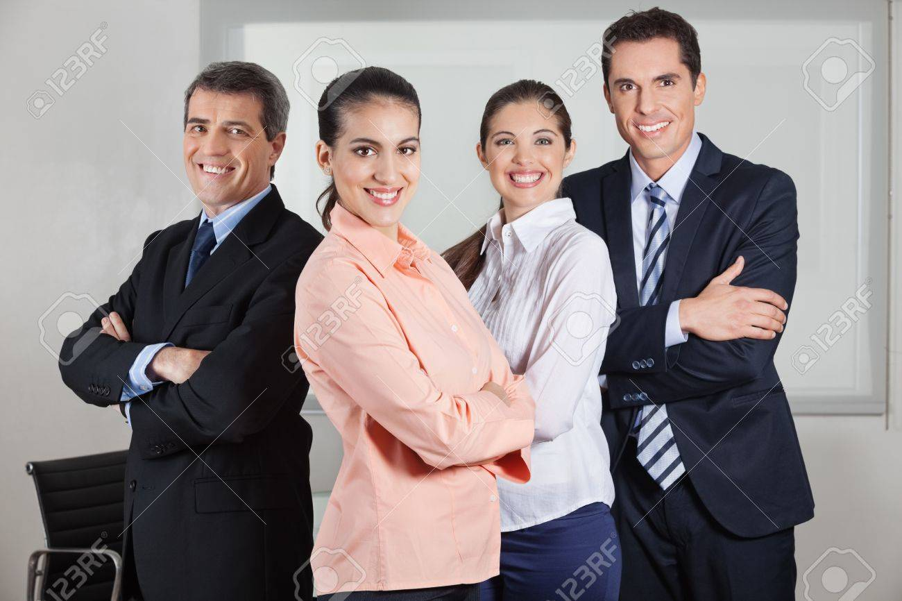 Dynamic happy busines team standing in the office with the arms crossed Stock Photo - 16128642