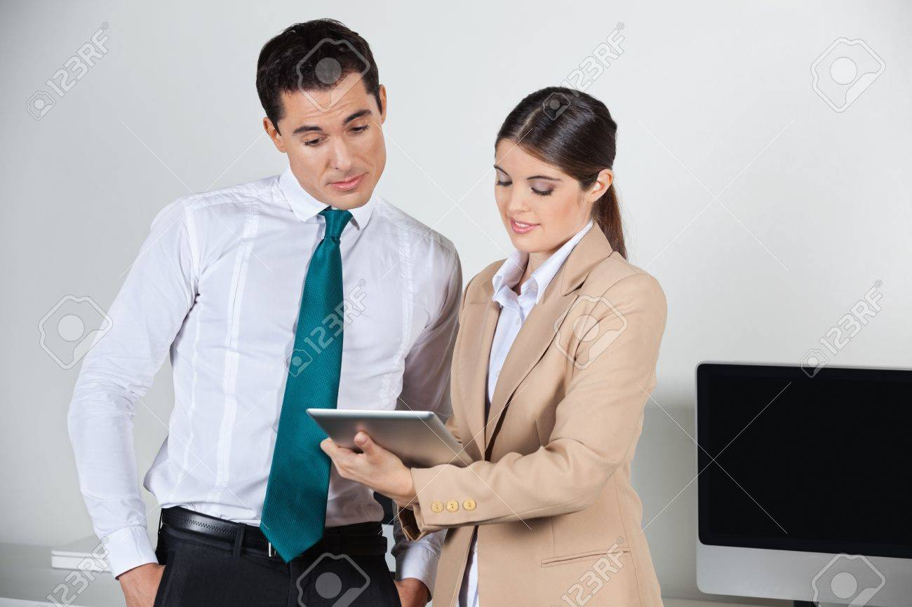 Secretary planning dates for her boss with a tablet pc in the office Stock Photo - 16253744