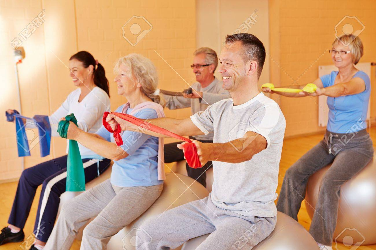 Reha sports for group of happy seniors in fitness center Stock Photo - 16502512