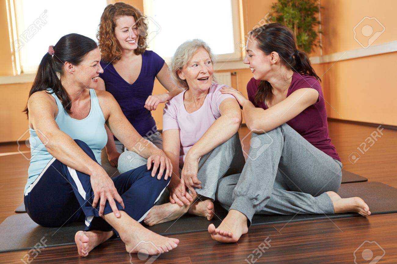 Happy group of smiling woman talking in a fitness center Stock Photo - 16502540