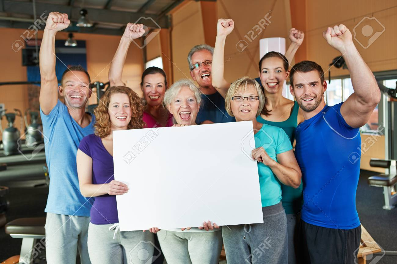Cheering group doing advertising for fitness center with empty white sign Stock Photo - 16490284