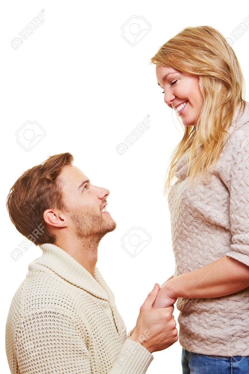Man asking for apolgy from his woman on his knees after an argument Stock Photo - 16931718