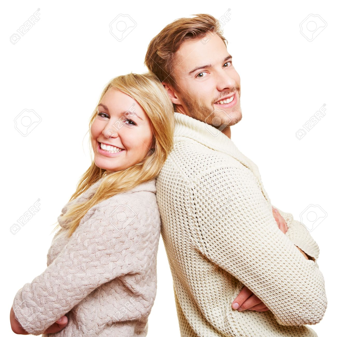 Happy couple leaning back to back with their arms crossed Stock Photo - 16979582