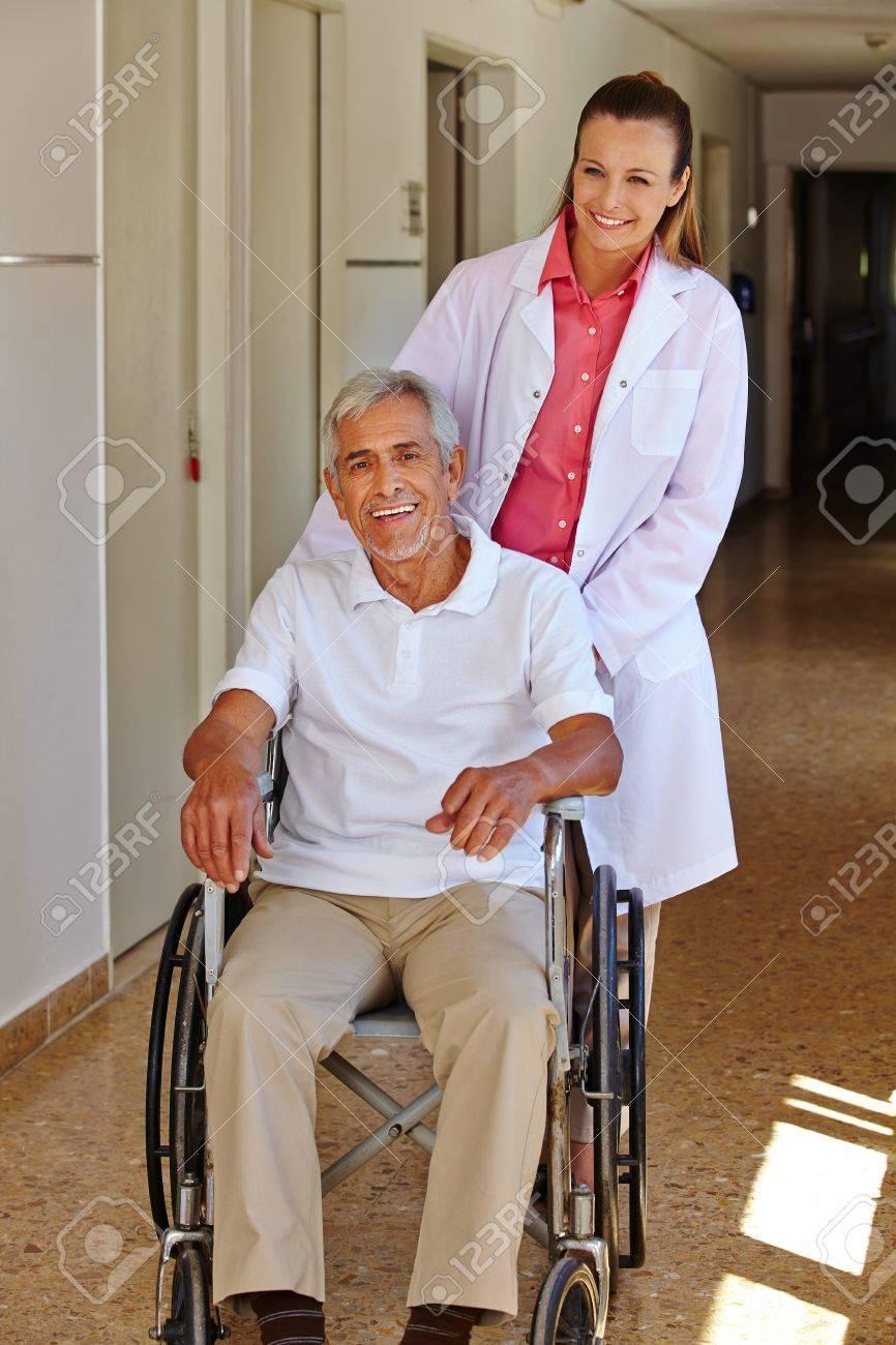 Geriatric nurse with senior man in wheelchair in a nursing home Stock Photo - 17660205
