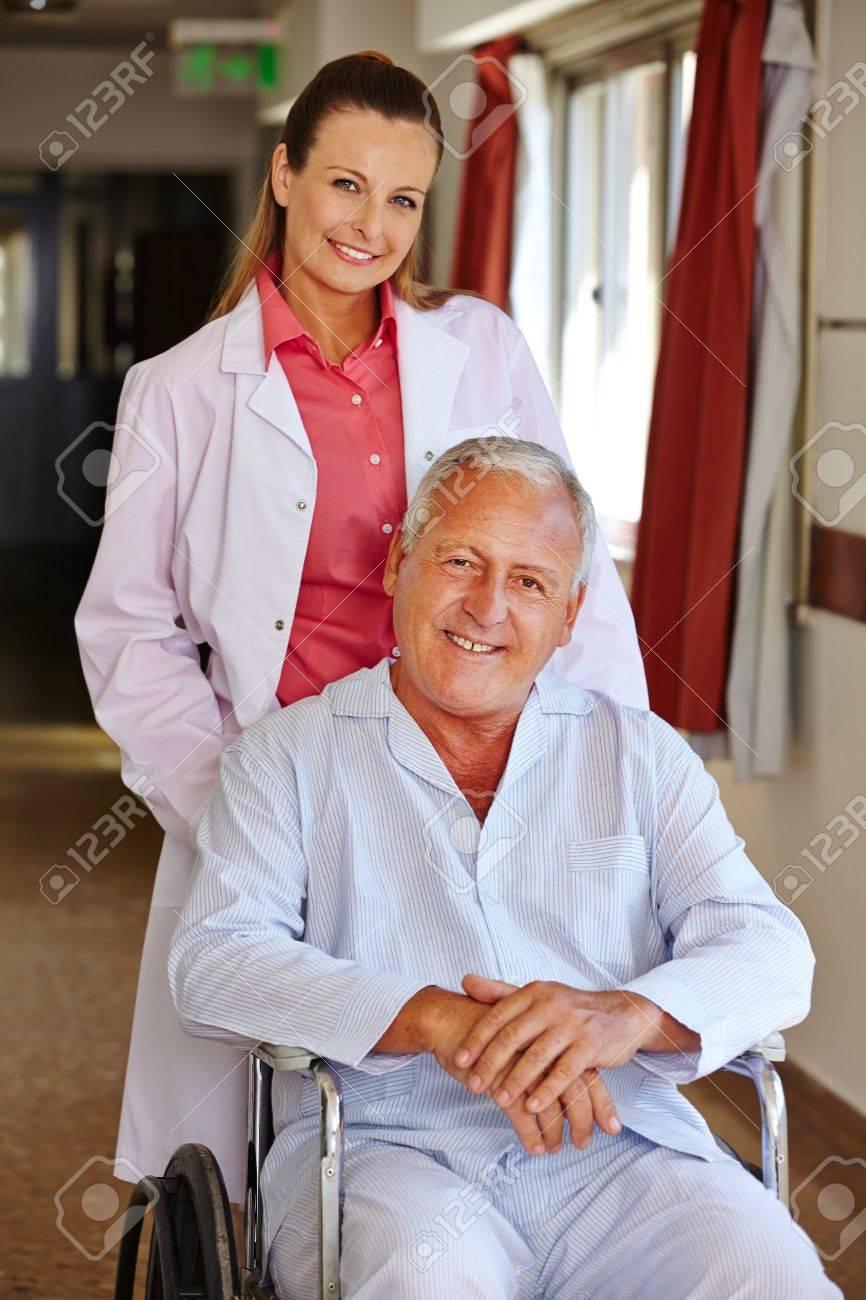 Nurse with senior man in wheelchair in a hospital Stock Photo - 17699354