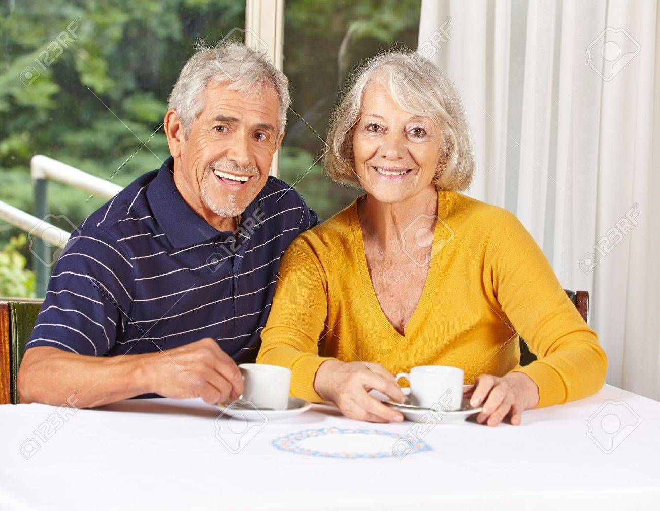 Happy senior couple drinking coffee in a retirement home Stock Photo - 17822097