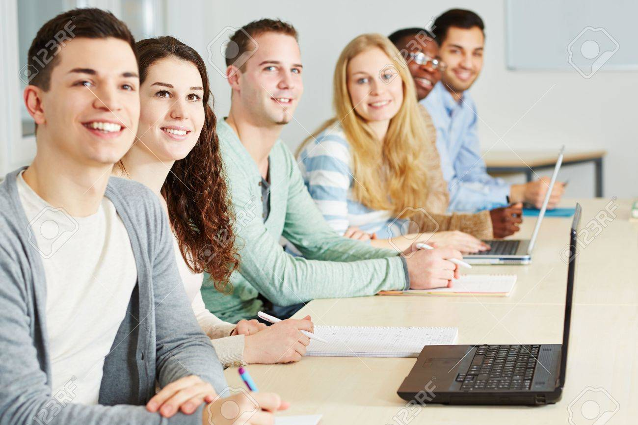Happy students learning in seminar of an university Stock Photo - 18385119