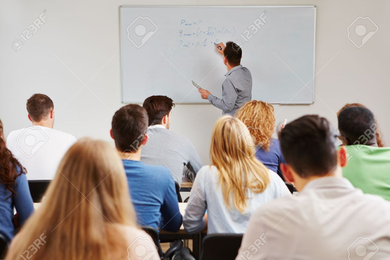 Teacher On Whiteboard In Class Teaching Business Studies In ...