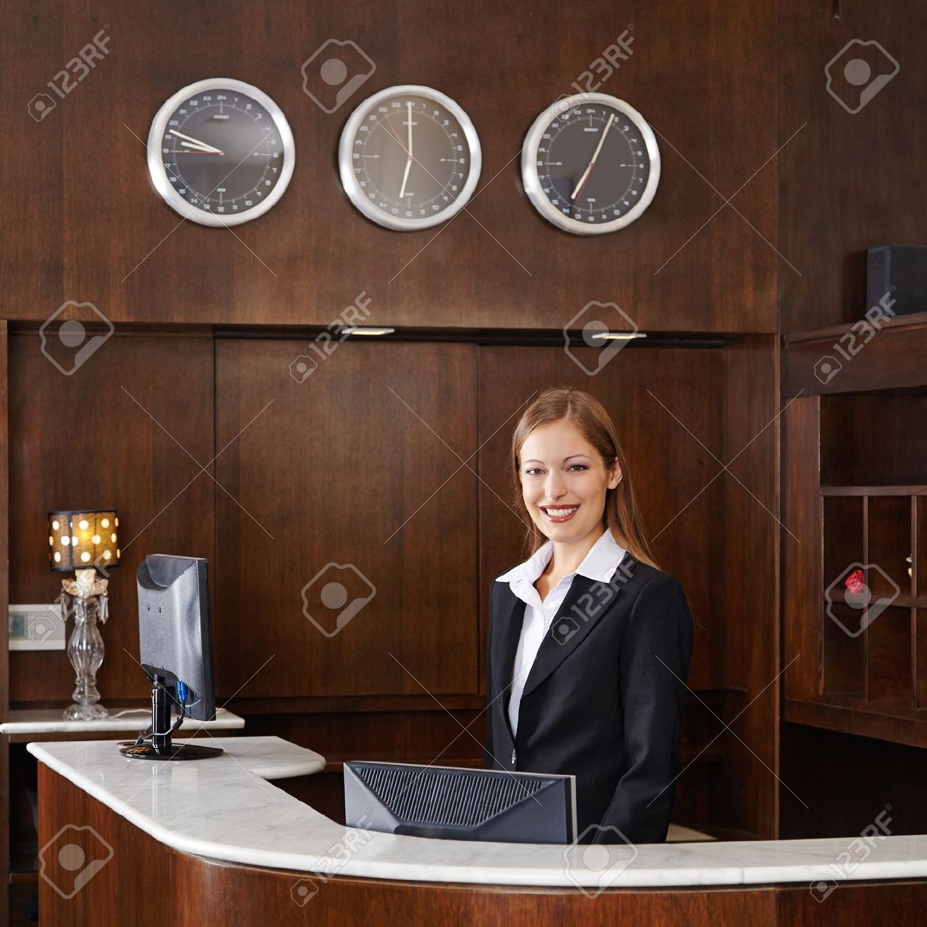 Happy female receptionist behind counter at hotel Stock Photo - 20104118
