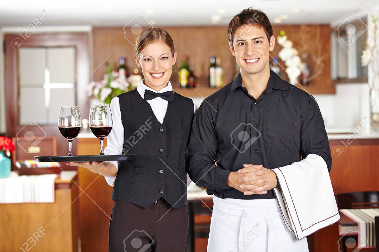Team of waiter staff with wine glasses in a restaurant Stock Photo - 20301896