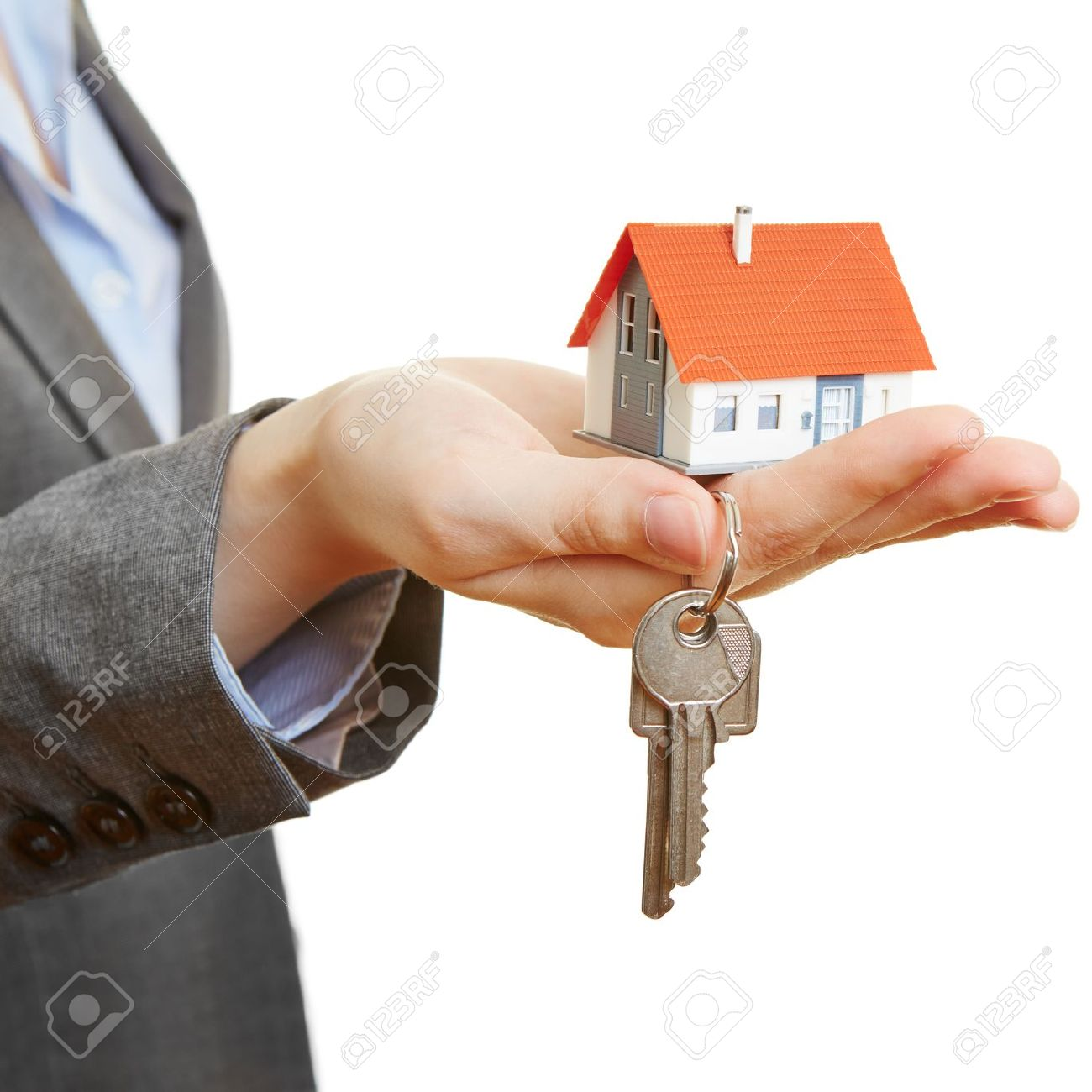 Hand Of A Woman Holding Little House And Keys Stock Photo Picture And Royalty Free Image Image 20936180