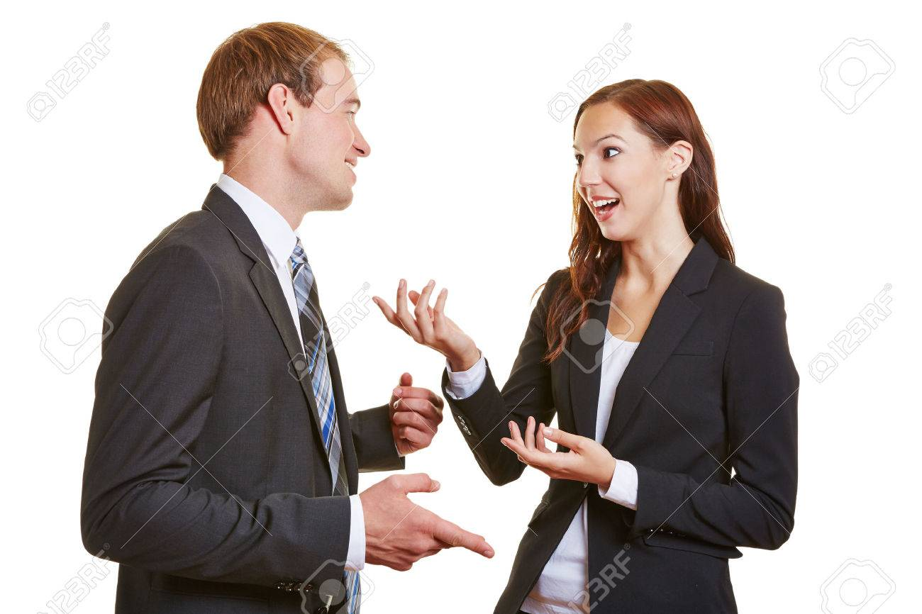 two business people talking engaged to each other and using their
