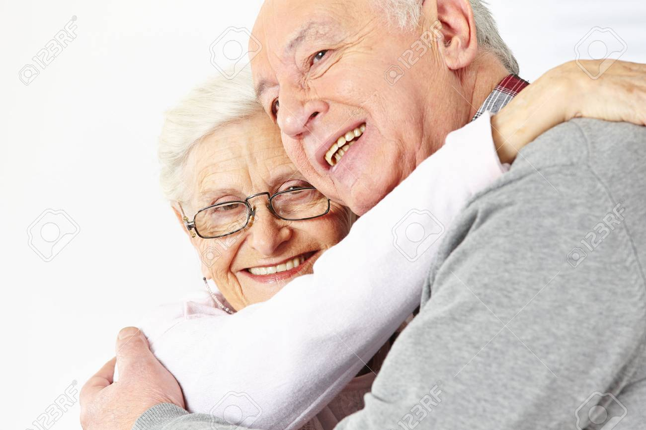 Happy senior couple embracing each other and smiling Stock Photo - 24050827