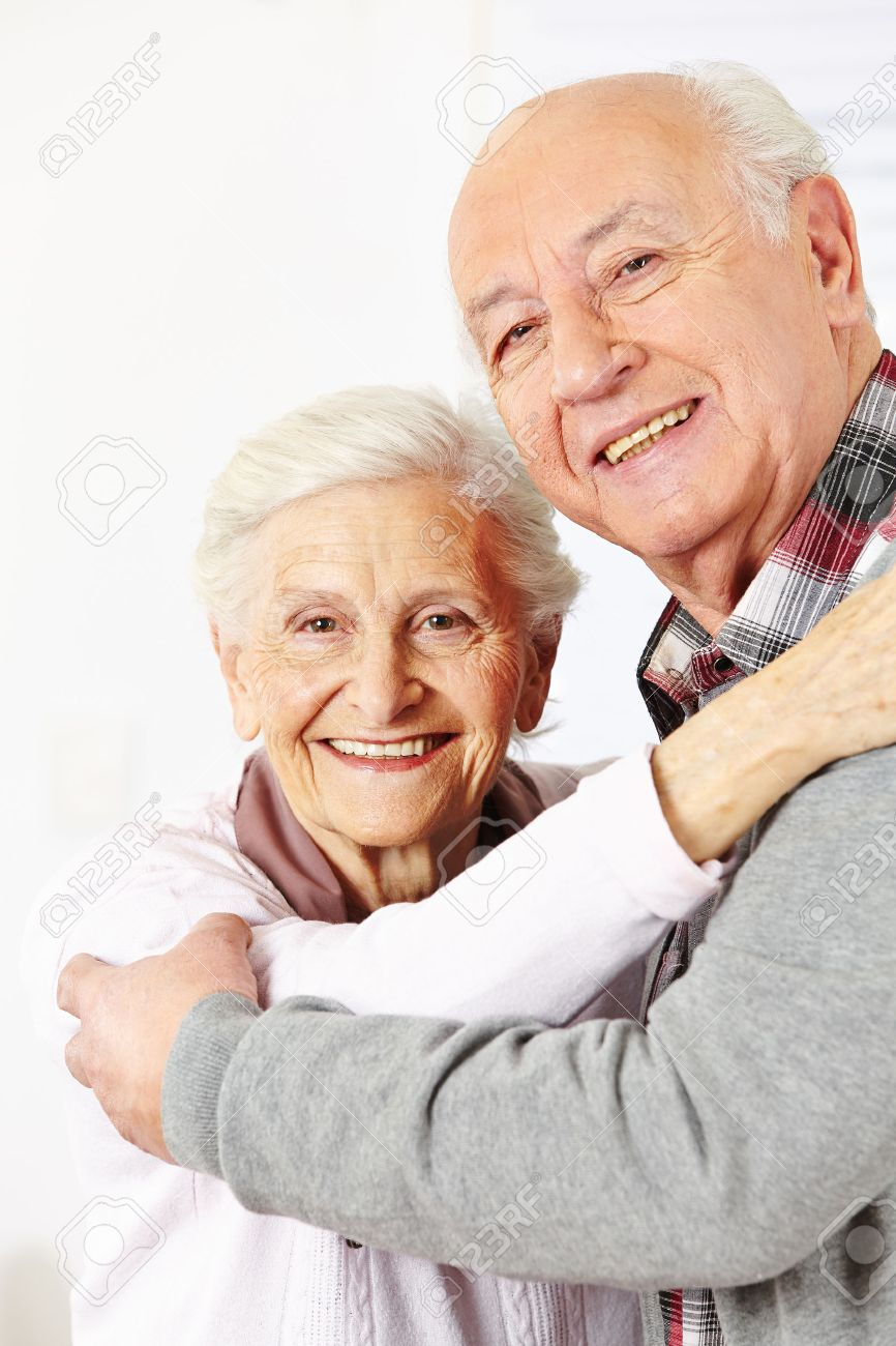 Happy senior citizen couple dancing together and smiling Stock Photo - 25216481
