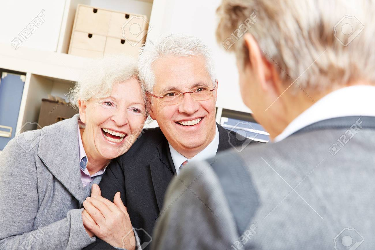 Happy senior couple getting legal consultation at lawyer Stock Photo - 27497358