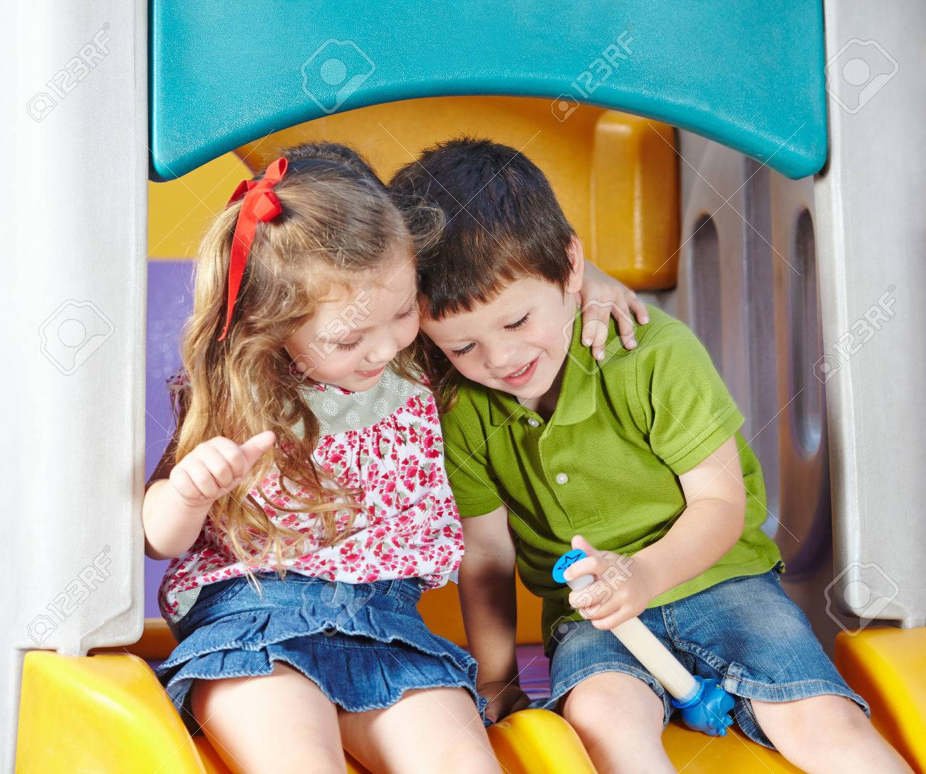 Boy and girl as children friends playing together in a kindergarten Stock Photo - 27574811