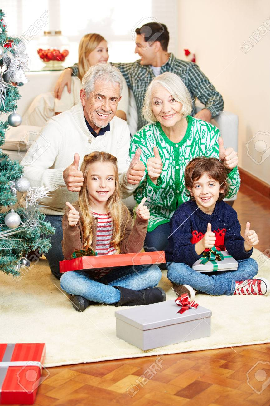 Happy family with grandparents making gift giving at christmas happy family with grandparents making gift giving at christmas eve stock photo 32926047 negle Gallery