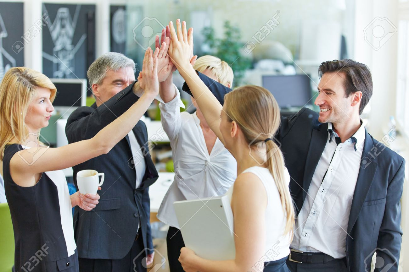 Happy business team making high five with their hands in the office Stock Photo - 39539640
