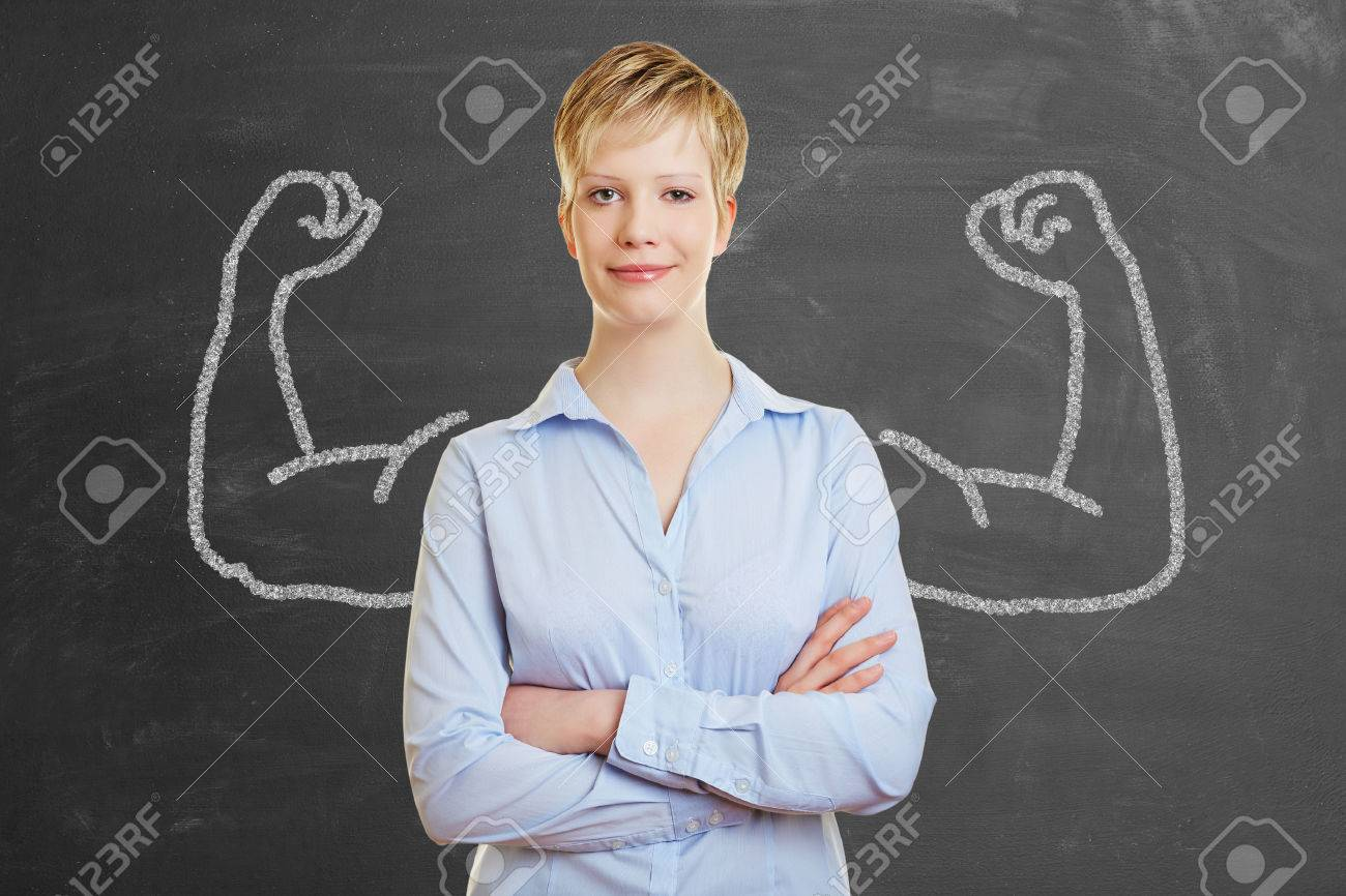 Strong business woman with chalk muscles in front of a blackboard Stock Photo - 39842394