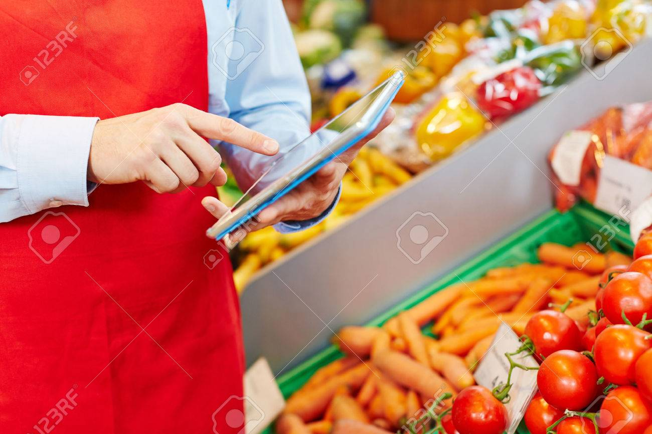 Store manager doing warehouse management with tablet computer in a supermarket Stock Photo - 40290641