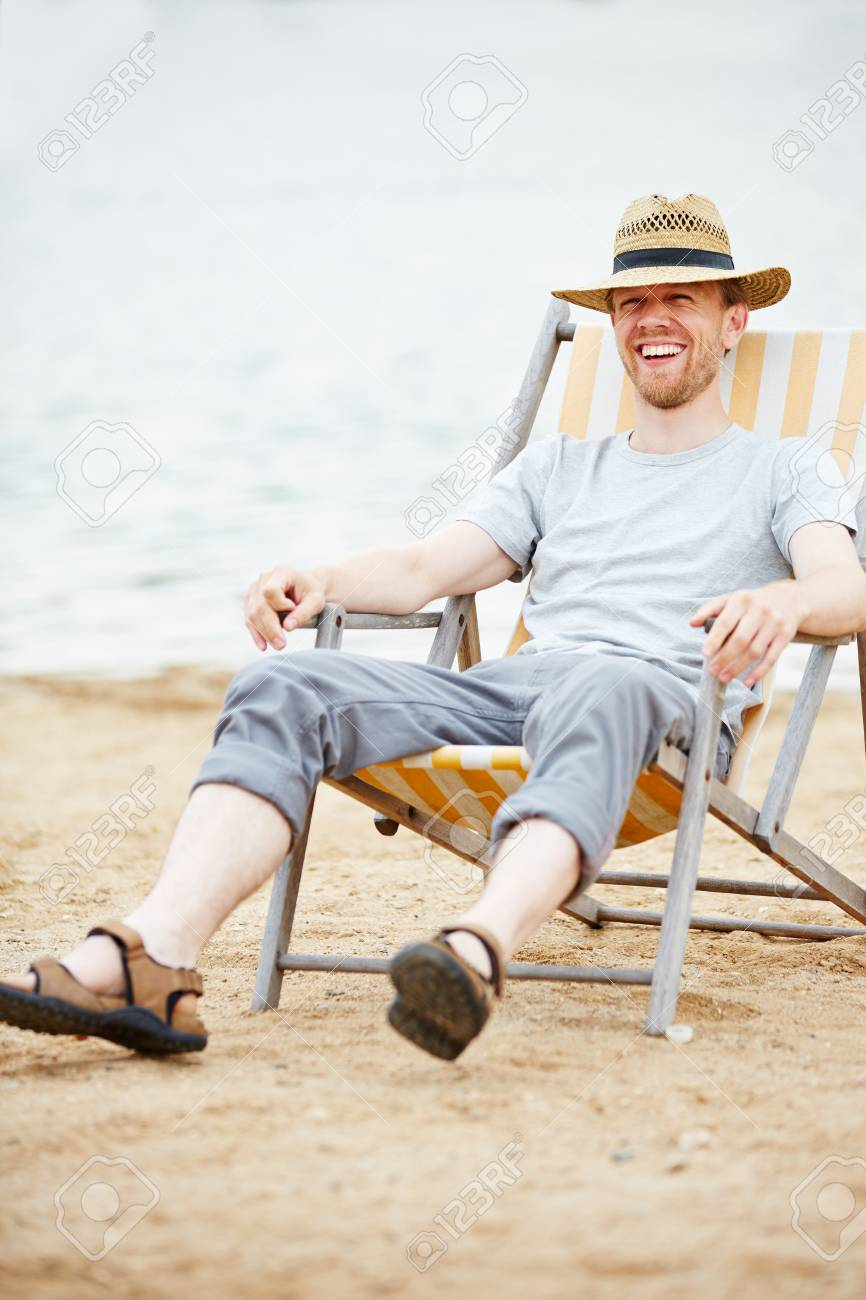 Happy Man Sitting Relaxed In Deck Chair On Beach In Summer Stock Photo Picture And Royalty Free Image Image 41480868