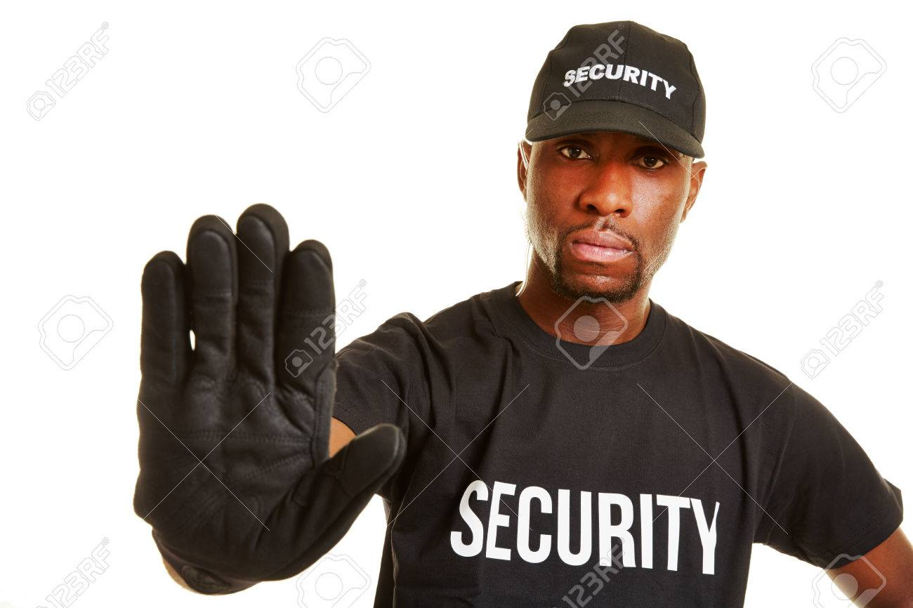 Security guard keeping distance with his hand Stock Photo - 43403228
