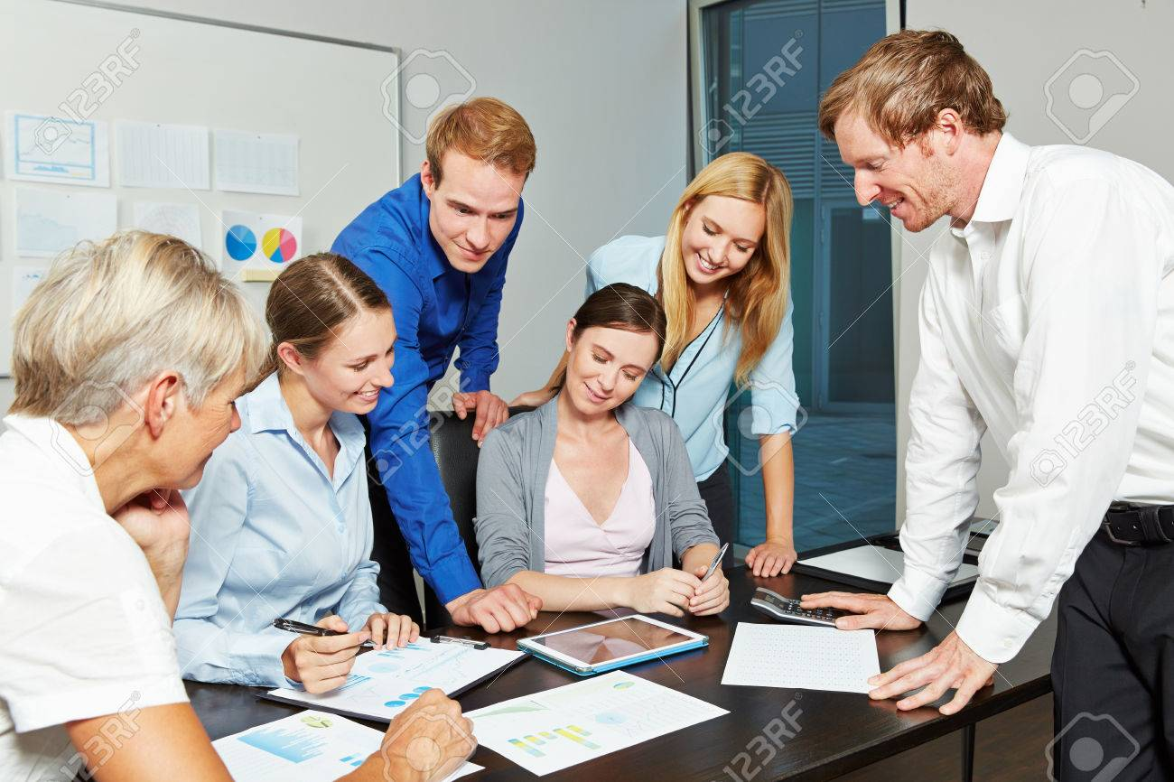 Young business people working together as a team in the office with tablet computer Stock Photo - 44132433
