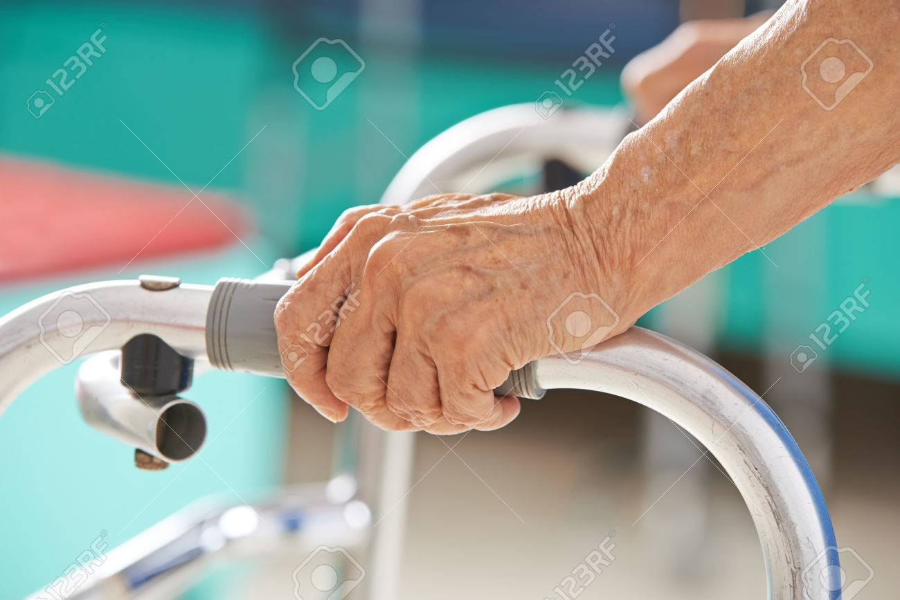 Old senior hands holding on to a walker for support Stock Photo - 46894445