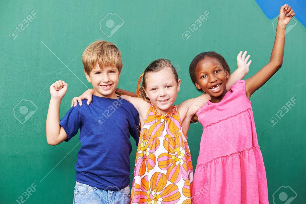 Cheering happy group of children in a kindergarten Stock Photo - 47628996