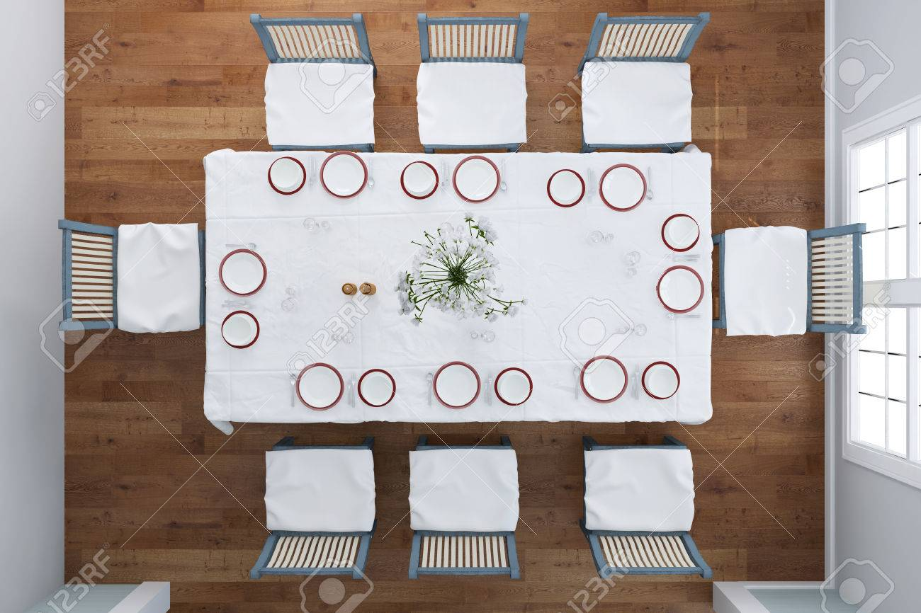 Top View On Set Table With Dishes And Cutlery In Dining Room Stock