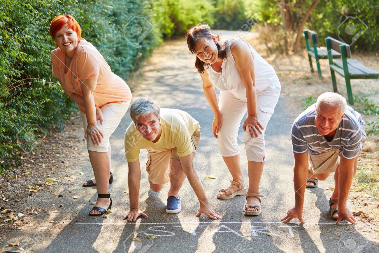 Group of seniors at the sart point of a race in summer at the park - 60672717