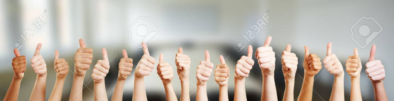 Many hands holding thumbs up in office - 62477786