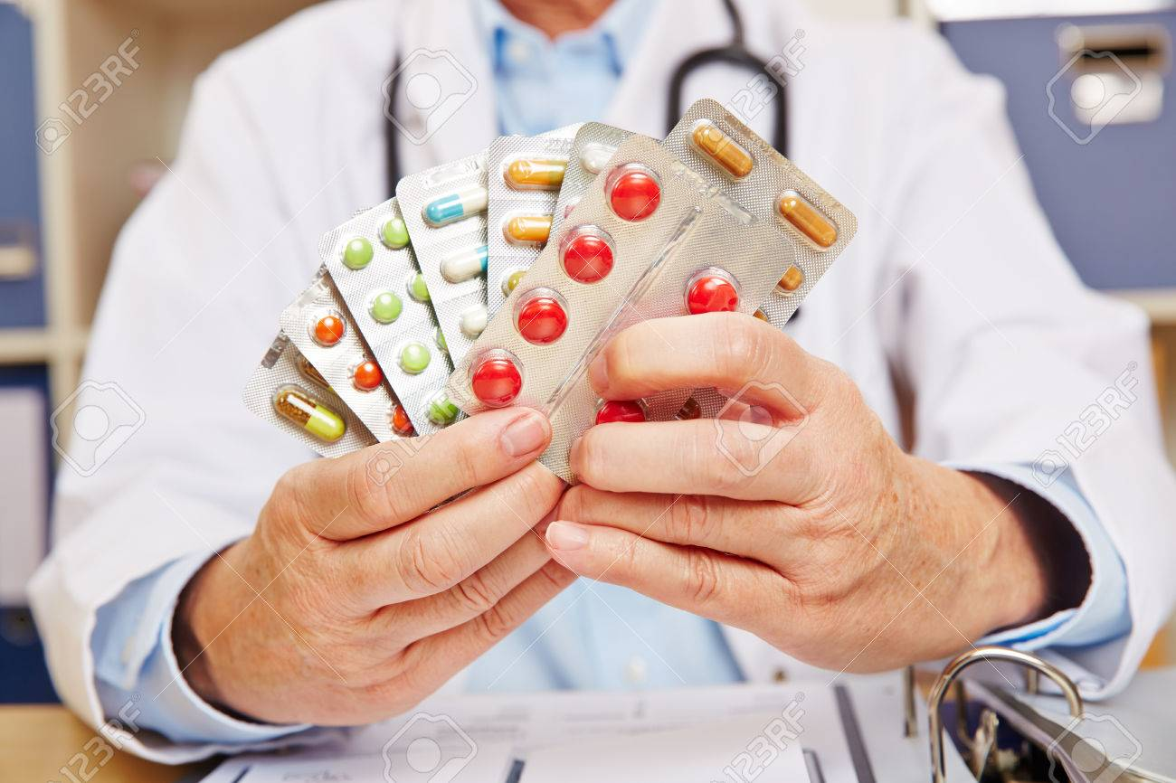 Doctor holding many prescription drugs in his hands Standard-Bild - 62307324