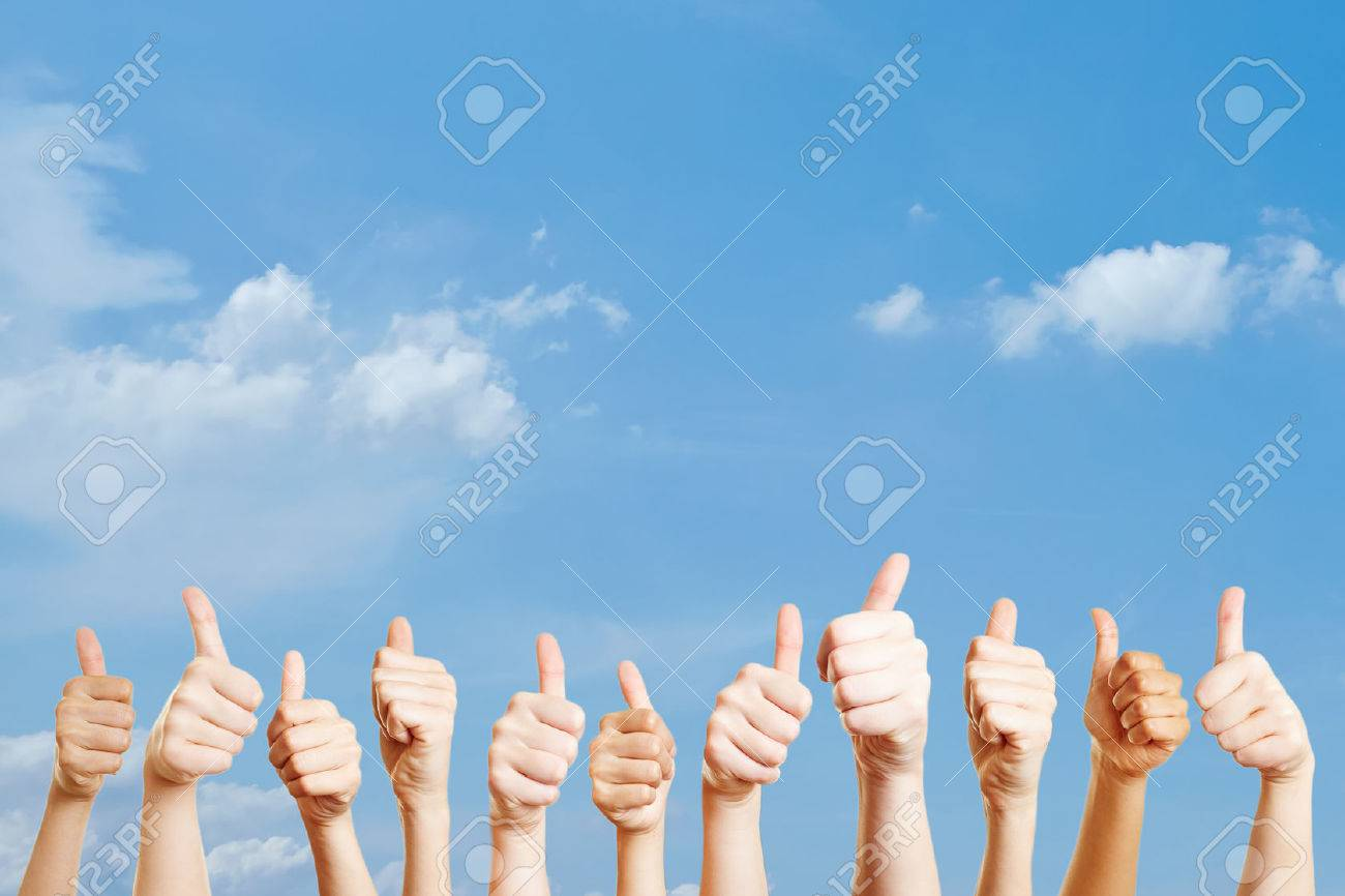 Many hands over the sky with thumbs up as motivation Standard-Bild - 65066486