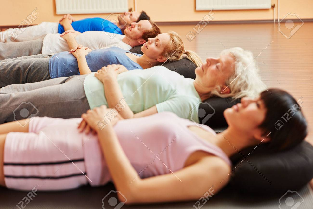 Senior and group during breathing exercise for relaxation at yoga class Standard-Bild - 65285900