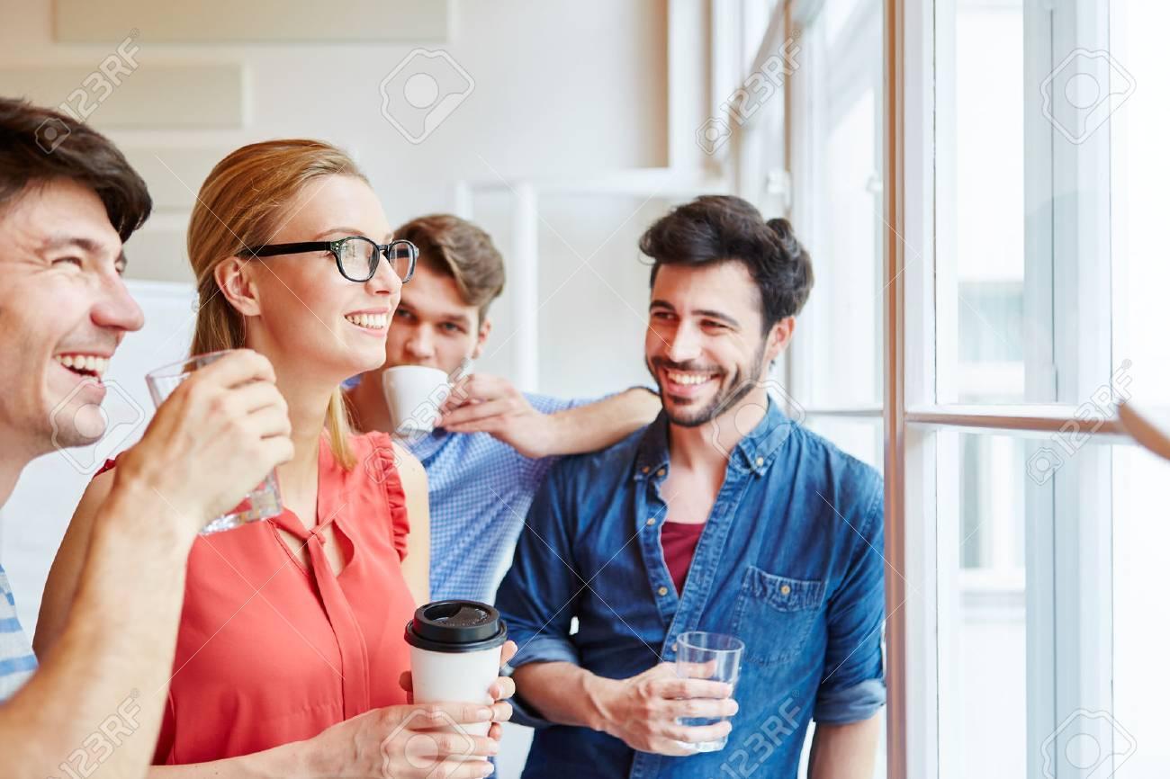 Take Break Coffeebreak : Successful start up team taking a coffee break stock photo