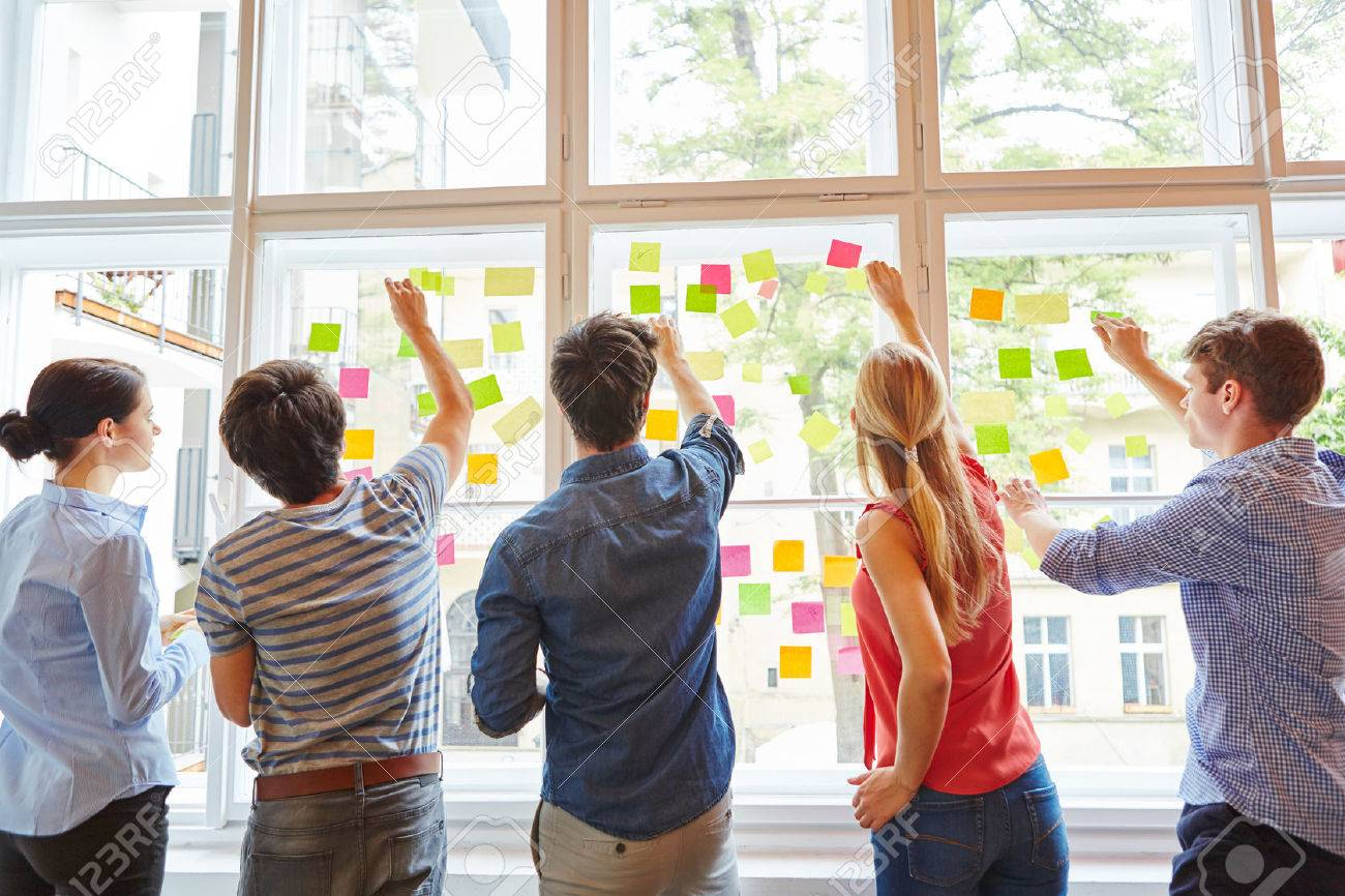 Young students at brainstorming seminar with colorful sticky notes - 63538341