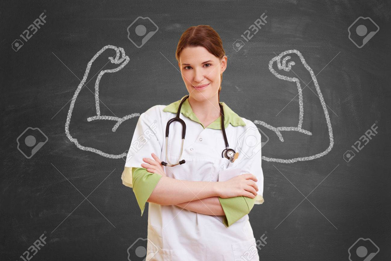 Self confident nurse woman with chalk muscles - 65285839