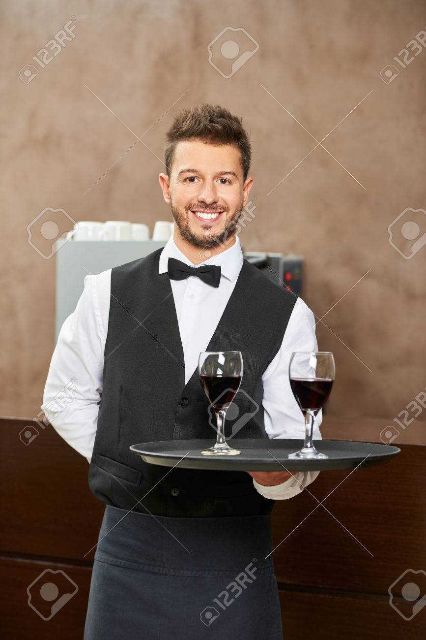 Waiter In Uniform Serving Red Wine In A Hotel Restaurant Stock Photo Picture And Royalty Free Image Image 75868598