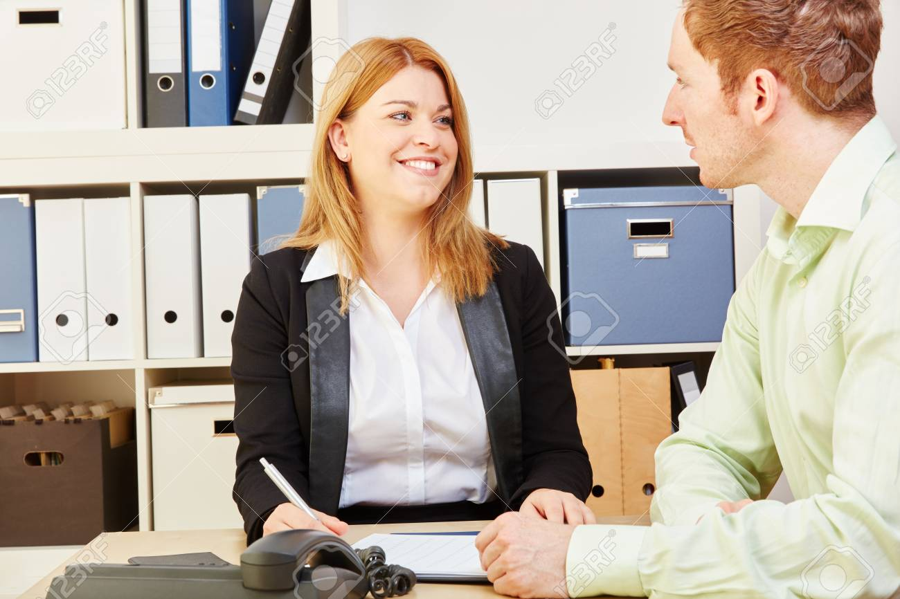 woman giving financial advice to a man for a credit1 stock photo