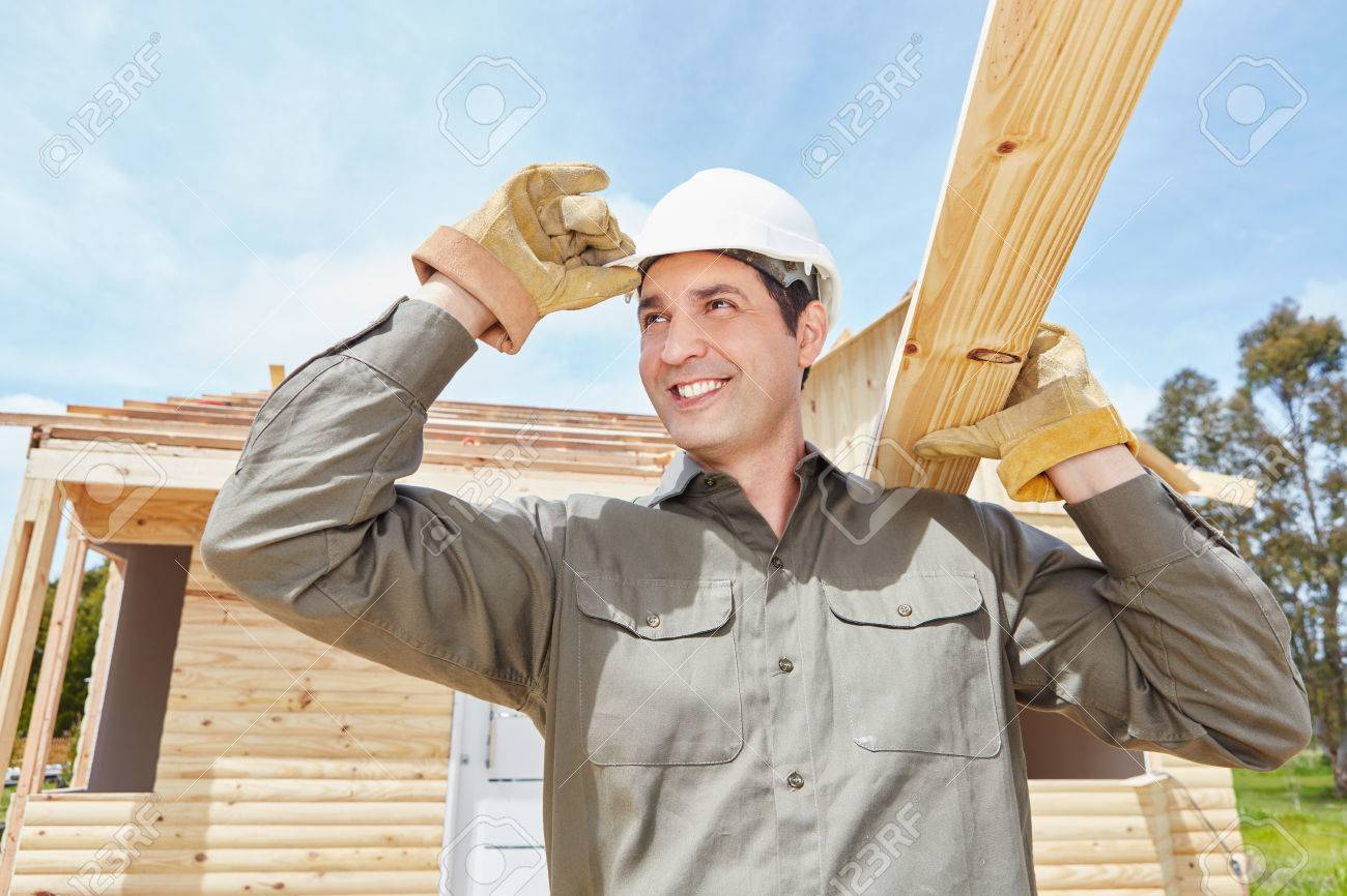 7a90e7d7abf Man as construction worker building house and carrying wood Stock Photo -  81444657